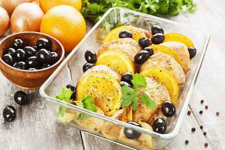 fricassee: Chicken with oranges and olives on the table Stock Photo