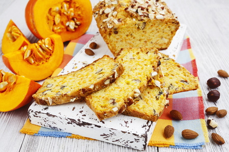 Homemade pumpkin cake with nuts on the table