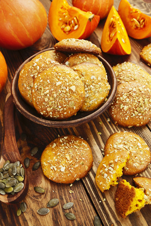 Homemade pumpkin cookies on the wooden table