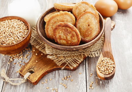 Buckwheat pancakes in the ceramic plate on the table Stock Photo