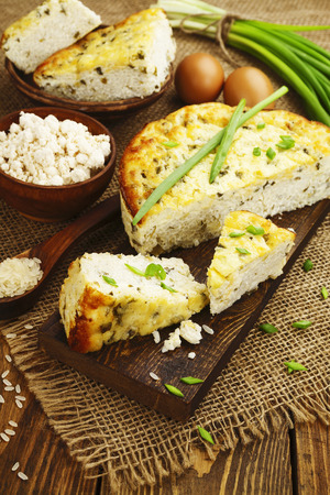 second breakfast: Rice pie with cottage cheese and spring onion Stock Photo