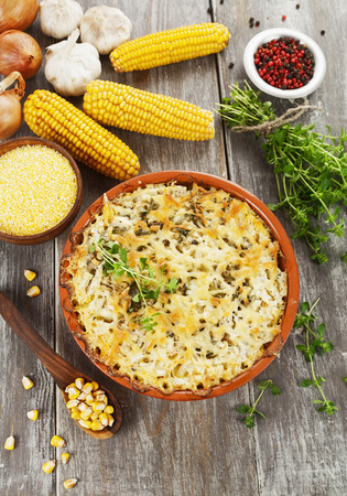 Fish baked with corn groats and cheese