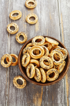 strewed: Dried biscuits with poppy seeds in the ceramic plate Stock Photo