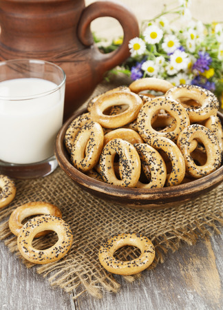Dried biscuits with poppy seeds and a glass of milk