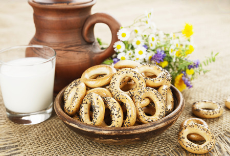 strewed: Dried biscuits with poppy seeds and a glass of milk