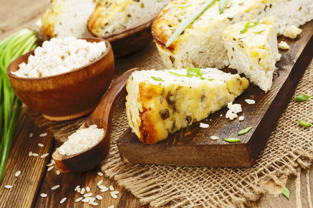 Rice pie with cottage cheese and spring onion Stock Photo