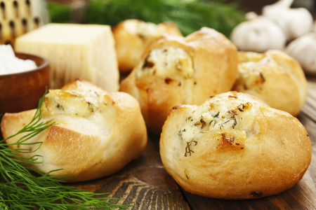 Baked buns stuffed with cheese and herbs Stock Photo