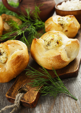 mini pizza: Baked buns stuffed with curd cheese and herbs