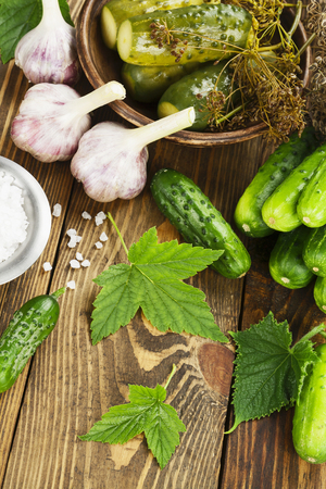 Fresh and pickled cucumbers on the wooden table Stock Photo