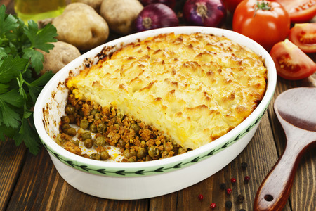 Cottage pie with meat and green peas Stock Photo