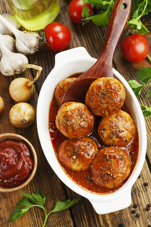 Meatballs with tomato sauce in the ceramic pot Stock Photo