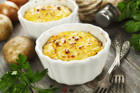 Potato casserole with meat on the wooden table Stock Photo