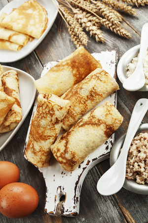 maslenitsa: Homemade  stuffed ?repes on the wooden table
