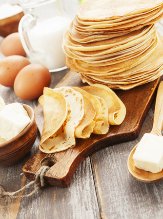 maslenitsa: Pancakes with butter on the wooden table