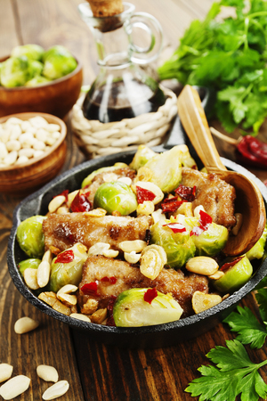 Stewed pork with brussels sprouts and peanuts