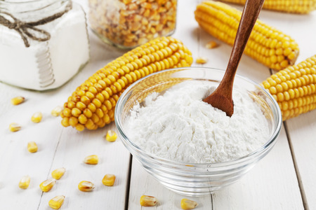 Starch and corn cob on the table Imagens