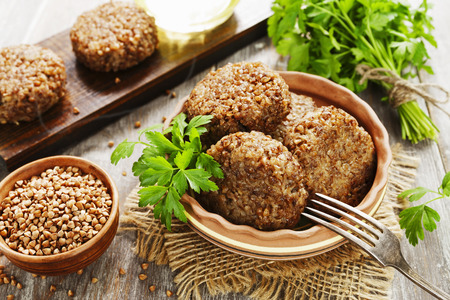 Vegetarian cutlets of buckwheat on the plate Archivio Fotografico