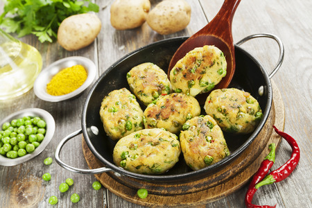 Potato cutlets with green peas. Aloo tikki. Indian food