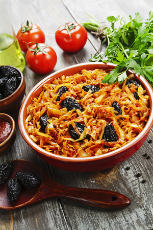 Cabbage stewed with prunes and tomato paste Stock Photo