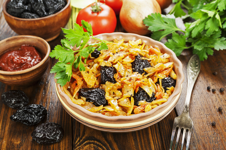 Cabbage stewed with prunes and tomato pasta Stock Photo