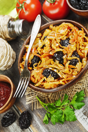 Cabbage stewed with prunes and tomato pasta