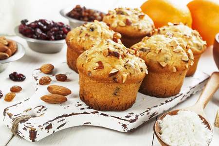 Orange muffins with dried fruits and nuts