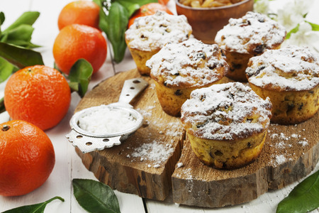Mandarin muffins with raisin and sugar powder on the table Stok Fotoğraf
