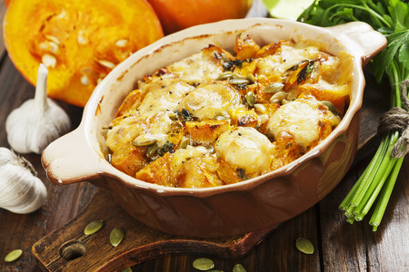 Chicken baked with pumpkin and cheese on the table