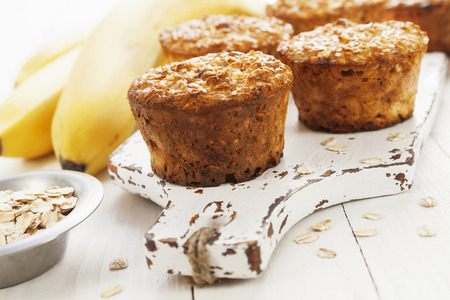 Diet oat muffins with banana on the table Stok Fotoğraf
