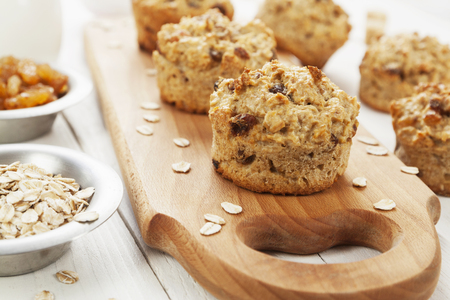 Diet oat muffins with raisins on the table