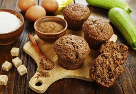 Zucchini muffins with cocoa powder on the table