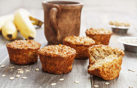 Diet oat muffins with banana on the table 免版税图像
