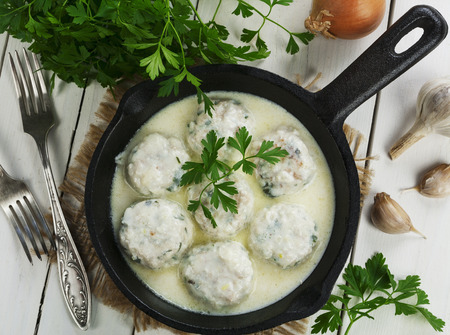 Chicken meatballs in milk sauce on the table