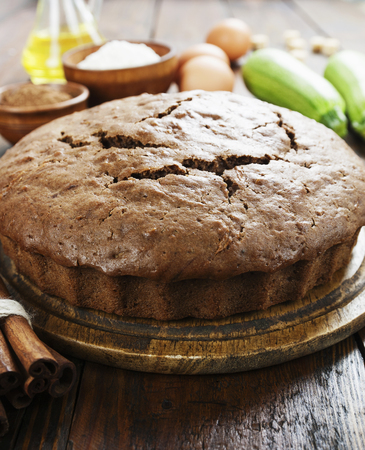 Zucchini cake with cocoa powder on the table Stock Photo