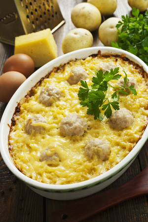 Potato casserole with meat balls and cheese