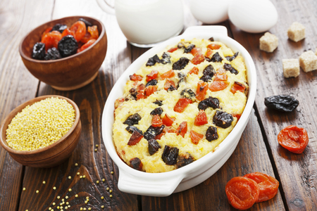 Millet casserole with dried fruits on the table Banque d'images