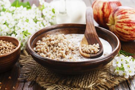 Buckwheat porridge with milk in the ceramic plate