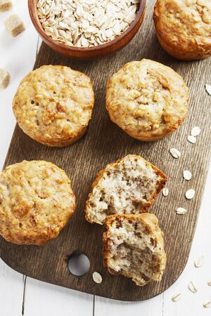 Banana muffins with oat flakes on the table