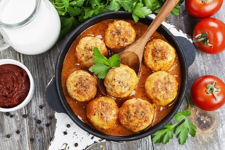 Meatballs in creamy tomato sauce in a pan Stock Photo