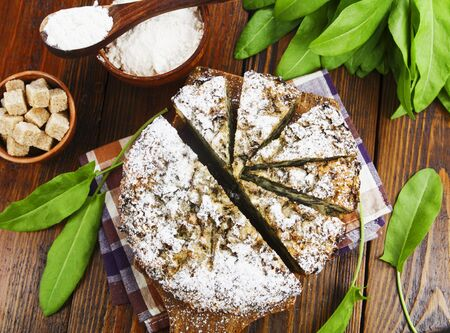 Pie with sorrel and icing sugar on the table