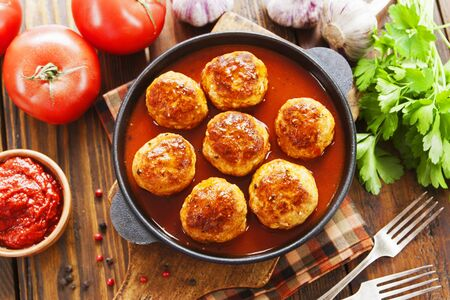 Meatballs in tomato sauce on the table Stock Photo