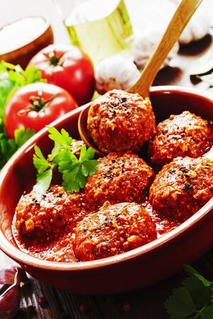 Meatballs with rice on a wooden table