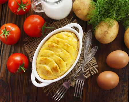 Potato casserole with meat on the wooden table Stok Fotoğraf