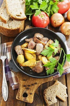 Potatoes stewed with chicken liver on the table Stock fotó
