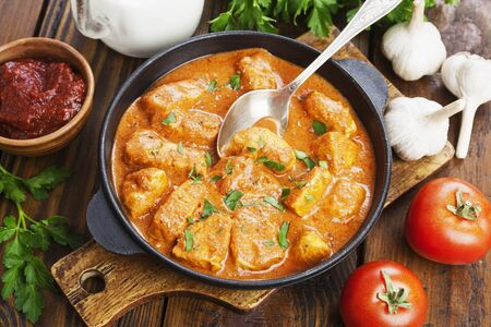 Meat in creamy tomato sauce in a pan