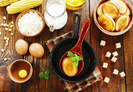 Pancakes with corn flour on the table