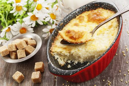 Homemade millet casserole on a wooden table Stockfoto