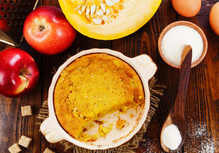 Pumpkin casserole with dried fruits on the wooden table