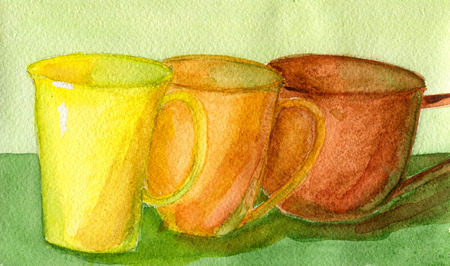 Three colored ceramic tea cups, bright household utensils photo