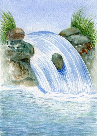 Waterfall flowing among stones flowing into sea